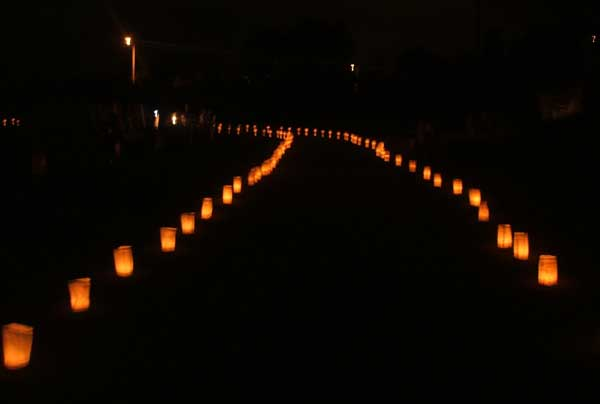 Relay for Life: luminaria commemorating survivors and victims line the track