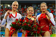 Shawn Johnson wins gold