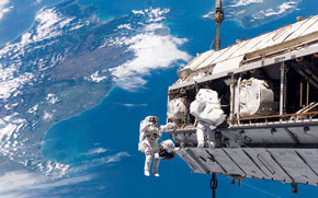 Space Shuttle: men at work, with a view (click to enbiggen!)