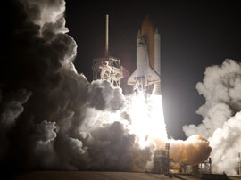 Space Shuttle blasts off (at night!)