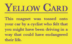 magnetic yellow card for cyclists to flag motorists