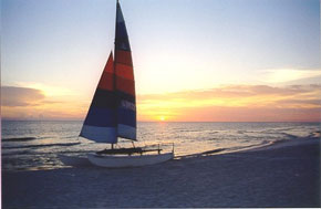 sailboat on the beach at sunset; awesome!