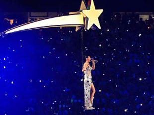 "Katie Perry flies through the air on a ""rocket"""